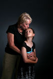 Grandmother kissing granddaughter royalty free stock images