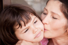 Grandmother kissing granddaughter, Family picture Royalty Free Stock Image