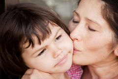 Grandmother kissing granddaughter, Family picture Stock Image