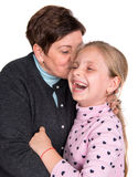 Grandmother kissing happy granddaughter Royalty Free Stock Images