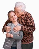 Grandmother kissing her granddaughter Royalty Free Stock Images