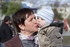 Grandmother kissing toddler Stock Images