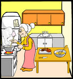 Grandmother In Kitchen Stock Images
