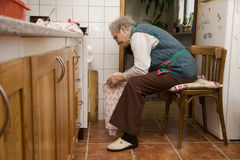 Grandmother in the kitchen Stock Image