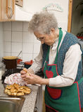 Grandmother in the kitchen Stock Photo