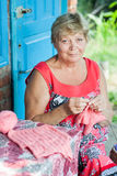 Grandmother knits. For grandchildren outdoor Stock Photography