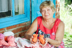 Grandmother knits Stock Photo