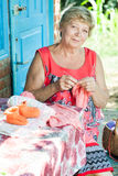 Grandmother knits Stock Photography