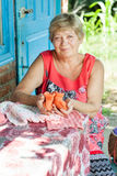 Grandmother knits Stock Images