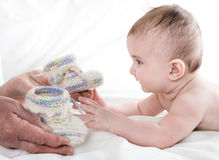Grandmother knitted baby socks warm Royalty Free Stock Photos