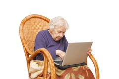 Grandmother with the laptop stock image