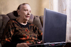 Grandmother with laptop Stock Photography