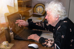 Grandmother learns to work at home on the computer Stock Images