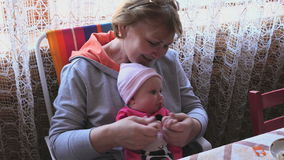 Grandmother with little baby girl stock video footage
