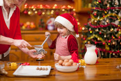 Grandmother and little girl baking Christmas cookies Stock Image
