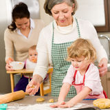 Grandmother with little girl prepare dough Royalty Free Stock Photos