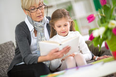 Grandmother and little girl reading book Royalty Free Stock Image