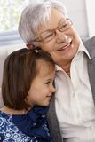 Grandmother and little girl smiling and hugging Royalty Free Stock Photography