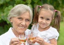 Grandmother with little girl Stock Photo