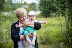Grandmother and little grandson outdoors summer Royalty Free Stock Photography