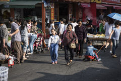 Grandmother looking after child, Shenzhen Royalty Free Stock Photos