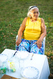Grandmother at lunch table Royalty Free Stock Photography