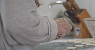 Grandmother makes a traditional Russian dish of dumplings, pelmeni, close-up.  stock video footage