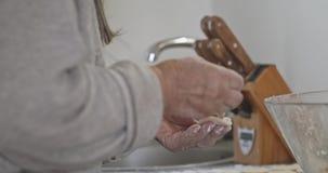 Grandmother makes a traditional Russian dish of dumplings, pelmeni, close-up.  stock video