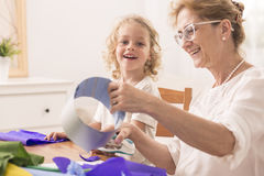 Grandmother making paper cuts Royalty Free Stock Photography