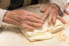 Grandmother making puff pastry Stock Photos