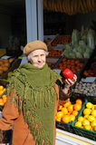 Grandmother on market. Hold in hand vegetable Royalty Free Stock Photos