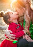 Grandmother and Mixed Race Baby Girl Kissing Outdoors. Grandmother and Mixed Race Sweet Baby Girl Kissing Outdoors stock image