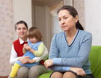Grandmother and mother with baby after quarrel Stock Photos