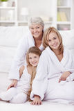 Grandmother, mother and daughter. In the morning in an apartment Royalty Free Stock Image
