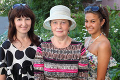 Grandmother, mother, daughter near cottage royalty free stock image
