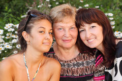 Grandmother, mother, daughter in park Stock Photos