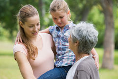 Grandmother mother and daughter at park Royalty Free Stock Image