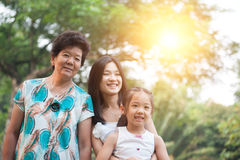 Grandmother, mother and daughter portrait. Stock Photo