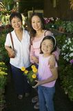 Grandmother mother and daughter Shopping for Plants in nursery portrait royalty free stock images