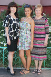 Grandmother, mother, daughter stand near cottage Royalty Free Stock Photo