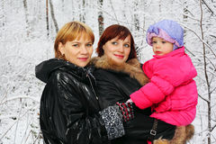 Grandmother, mother and daughter stand in woods stock image