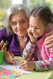 Grandmother and mother drawing Stock Photos