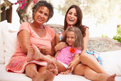 Grandmother,Mother And Granddaughter Sitting Outdoors� Royalty Free Stock Images