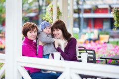 Grandmother, mother and little son in cafe. Three generations family - grandmother, mother and little son spending time together in an outdoor cafe Royalty Free Stock Photography