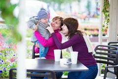 Grandmother, mother and little son in cafe Stock Image