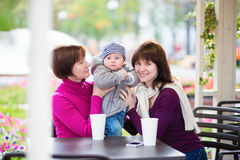 Grandmother, mother and little son in cafe Royalty Free Stock Photo