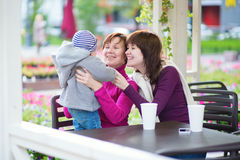 Grandmother, mother and little son in cafe Stock Photo