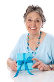 Grandmother on Mother's Day - elder woman isolated on white back. Grandmother isolated on Mother's Day with gift Stock Image