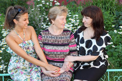 Grandmother, mother and smiling daughter seat Royalty Free Stock Image
