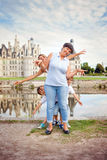 Grandmother, mother and two children, boys brothers, having fun. In front of the Chambord castle, chateaux on Loire river, France Stock Photos